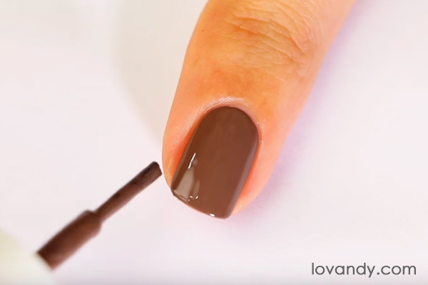 paint nail with a base brown color